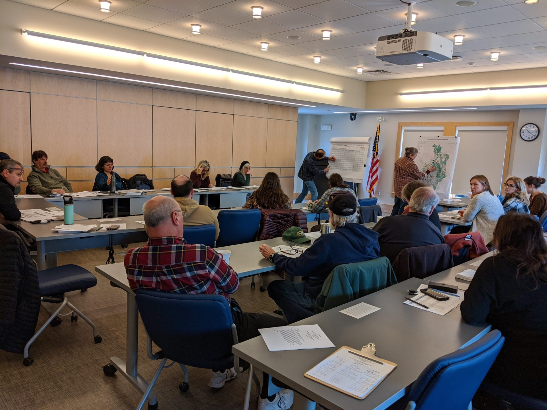 An image of a stakeholder engagement meeting where participants from the Assawompset Pond Complex Management Team give their input into top priorities in the watershed.
