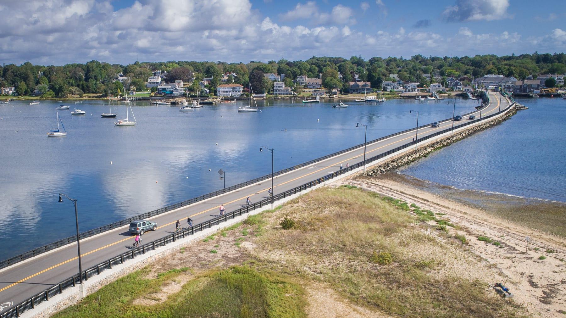 Members of the South Coast Bikeway Alliance ride across Dartmouth's Padanaram Bridge